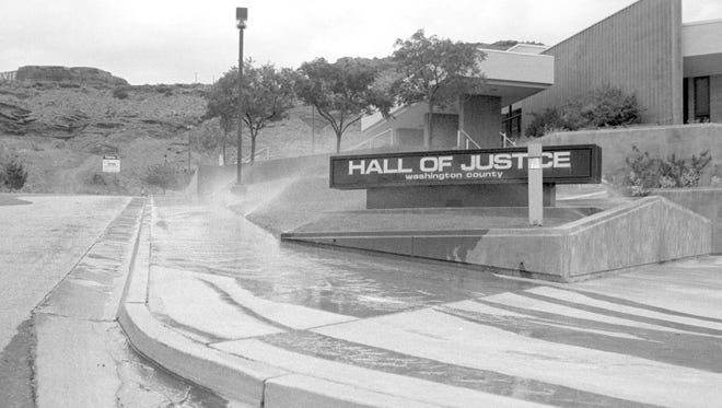 In July of 1989 the City of St. George implemented water restrictions but Washington County's maintenance crew apparently didn't get the memo. Spectrum photographer Nancy Rhodes captured the then image of the sprinklers watering the grass at what was then the Washington County Hall of Justice at about 7:30pm, according to the information written on the negative sleeve that contained the film on which the then image was captured. The Hall of Justice at one time housed the Washington County Sheriff's Office and the county jail until both were moved to Purgatory Correctional Facility in the late 1990s. In addition Utah's 5th District Court occupied the top floor of the building until late 2009 when the court moved to its current home on Tabernacle Street. The building was purchased by the City of St. George after the court moved out and now houses the St. George City Leisure Services offices. In the background at left, in the then image you can see the road that leads up to Red Hills Parkway did not exist in 1989 and neither did the office building that can be seen in the top left of the now image taken by Spectrum & Daily News photographer Jud Burkett.