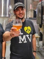 Sergio Moutela, the owner of Melovino Meadery, raises a glass of mead, an alcoholic beverage fermented from honey.