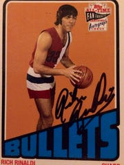 Poughkeepsie's Rich Rinaldi has kept a few of his autographed basketball cards from the 1970s.
