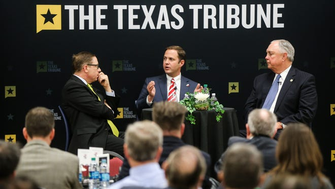 Texas Tribune CEO Evan Smith (left) leads a discussion with Rep. Dustin Burrows of Lubbock (center) and Rep. Drew Darby of San Angelo about intents of the 85th Texas Legislature on Thursday at Howard College.