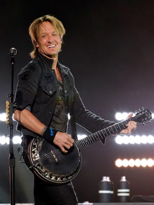 "Keith Urban plays a banjo opening on ""Gone Tomorrow."""
