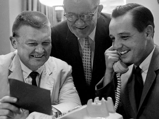 Tennessean editorial writer Gene Graham, left, reads