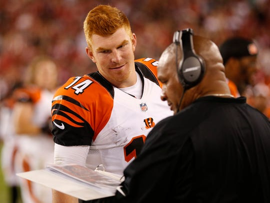 Bengals quarterback Andy Dalton talks with offensive