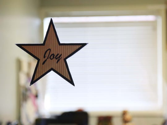 A star nametag hangs on the door to Joy's dressing