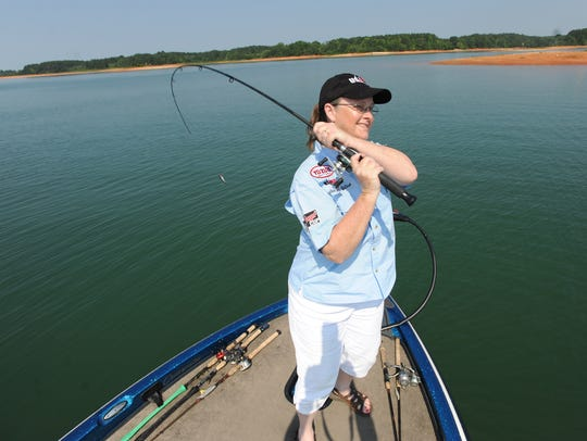 Martha Goodfellow fishes on Hartwell Lake on Wednesday,