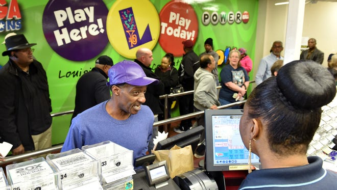 Dozens of customers pack into Delta Discount Wine & Spirits in Delta, La., for their chance at winning a record Powerball.