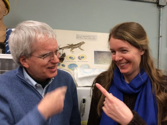 Malaria researcher Ellen Martinsen jokes with her mentor, Professor Emeritus Joe Schall, in mid-February at his malaria research lab at University of Vermont. Martinsen, who earned her doctorate at UVM, is now an adjunct professor at the university, as well as a researcher at the Smithsonian's Conservation Biology Institute in Washington, D.C.