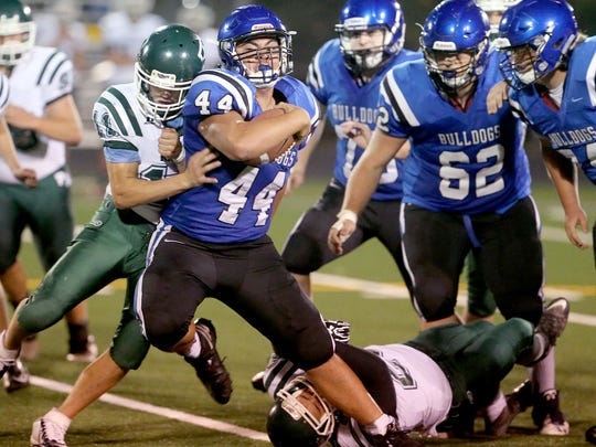 North Mason running back Dylan Tupolo (44) strains for more yards Friday night at Phil Pugh Stadium in Belfair. Tupolo finished with 131 yards rushing in the Bulldogs' 13-2 loss.