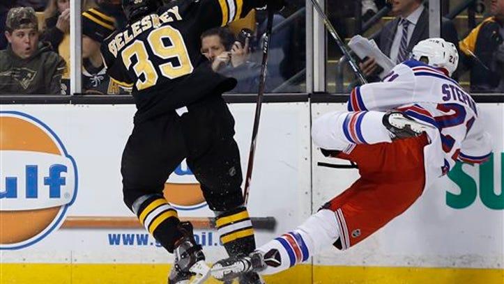 Boston's Matt Beleskey (39) levels the Rangers' Derek
