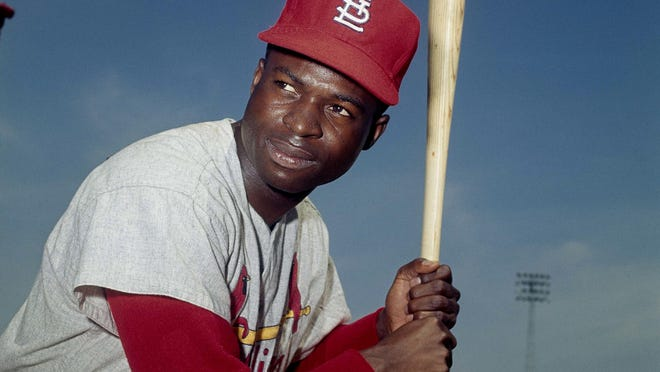 In this April 9, 1965, file photo, Lou Brock, of the St. Louis Cardinals, poses in Missouri. Hall of Famer Brock, one of baseball's signature leadoff hitters and base stealers who helped the Cardinals win three pennants and two World Series titles in the 1960s, has died. He was 81.
