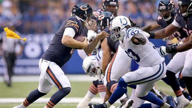 Indianapolis Colts outside linebacker Erik Walden (93) chases down Chicago Bears quarterback Jay Cutler (6) in the first half of their preseason game Saturday, August 22, 2015, evening at Lucas Oil Stadium.