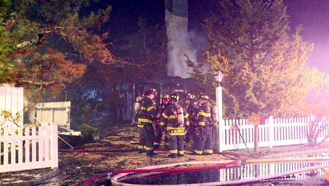 Firefighters are shown at the scene of a multiple alarm fire at 217 Channel Lane in Mantoloking Saturday night, February 27, 2016.  IMAGE COURTESY OF STATE NEWS SERVICE ~