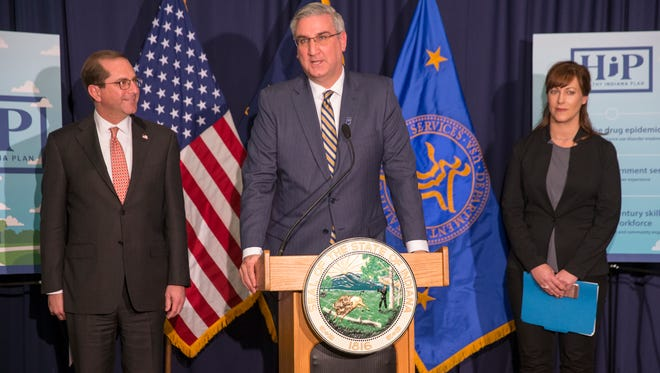 Alex Azar (left), U.S. Secretary of Health and Human Services, Indiana Governor Eric Holcomb, and Dr. Jennifer Walthal, Director of Indiana's Family and Social Services Administration address the federal approval going forward of the in-place Healthy Indiana Plan, Eskenazi Hospital, Indianapolis, Friday, Feb. 2, 2018. Part of the plan includes as much as $80 million to be spent addressing the opioid epidemic in Indiana.