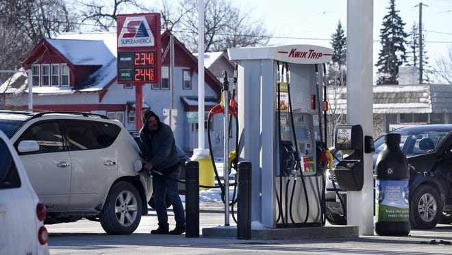 A customer fills his tank at the Kwik Trip on Division Street in St. Cloud in this January, 2018, file photo.