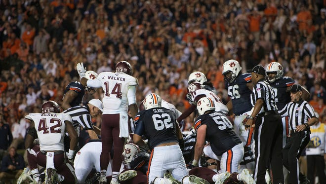 Texas A&M linebacker Josh Walker (14) points for the ball to be Auburn's during the NCAA football game between Auburn and Texas A&M on Saturday, Nov. 8, 2014, in Auburn, Ala. Texas A&M defeated Auburn 41-28 after Auburn fumbled twice on there last two drives.