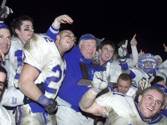 Manasquan coach Vic Kubu is surrounded by his players