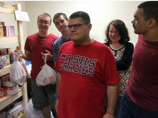 """Chambersburg Area Senior High School """"Super Seniors"""" do a variety of work to gain insight into potential employment, including participating in the """"Power Packs"""" program that provides about 50 families of Stevens Elementary students with meals over weekends."""