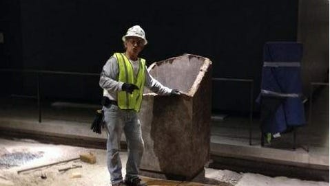 "Rene C. Lopez working at the ""Footprints of the North Tower"" at the 9/11 Memorial Museum in New York City."