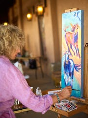 Barbara Meikle painting at the 2017 Quick Draw.