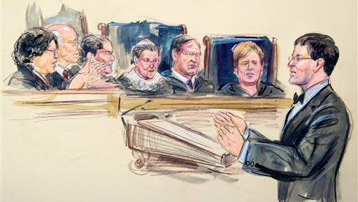This artist rendering shows former Michigan Solicitor General John Bursch defending state laws during the Supreme Court hearing on same-sex marriage, Tuesday, April 28, 2015, in Washington.  Justice from left are, Sonia Sotomayor, Stephen Breyer, Antonin Scalia,, Ruth Bader Ginsburg, Samuel Alito Jr. and Elena Kagan.