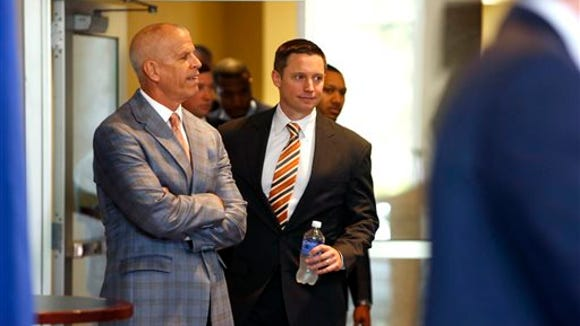 In this May, 2015 file photo, Florida Athletic Director Jeremy Foley, left, arrives with new Florida basketball head coach Mike White for a press conference in Gainesville, Fla.