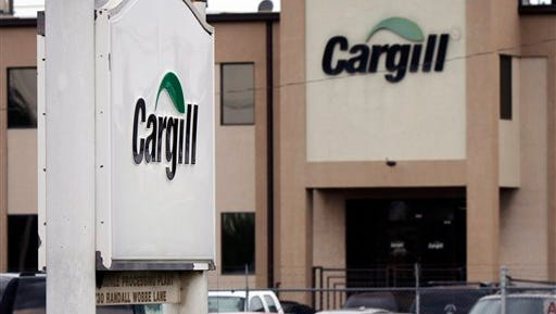 In this Aug. 4, 2011 photo, cars are parked at the Cargill Inc., turkey processing plant in Springdale, Ark. Cargill has recalled 40 of 130 workers who were laid off last summer following two recalls of ground turkey. (AP Photo/Danny Johnston)
