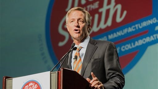 Tennessee Gov. Bill Haslam speaks at the Southern Automotive Conference in Nashville, Tenn., on Tuesday, Oct. 20, 2015. The governor expressed hopes that Volkswagen's emissions cheating scandal won't hurt Tennessee's efforts to lure the German automaker's North American headquarters to the state. (AP Photo/Erik Schelzig)