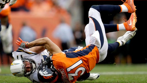 Denver Broncos free safety Justin Simmons (31) sacks San Diego Chargers quarterback Philip Rivers (17) during the second half of an NFL football game, Sunday, Oct. 30, 2016, in Denver. (AP Photo/Jack Dempsey)