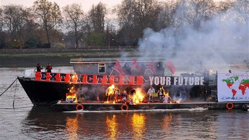 Joe Corre, the son of Vivienne Westwood and Sex Pistols creator Malcolm McLaren, burns his £5 million punk collection on a boat on the River Thames in London, Saturday, Nov. 26, 2016.