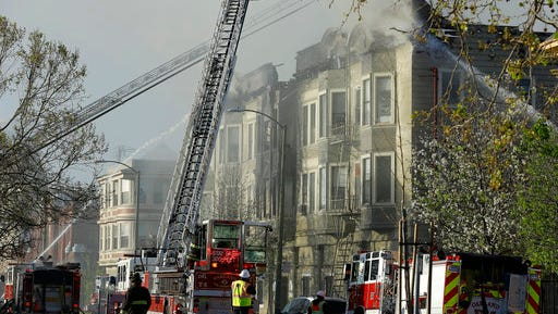 Firefighters battle an early morning apartment fire Monday, March 27, 2017, in Oakland, Calif.