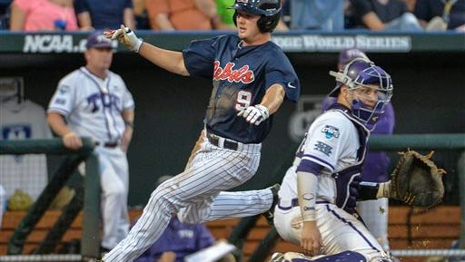 Ole Miss' Auston Bousfield (9) runs past TCU catcher Kyle Bacak (6) on his way to score on a single by Sikes Orvis in the fifth inning of an NCAA baseball College World Series elimination game in Omaha, Neb., Thursday, June 19, 2014. (AP Photo/Ted Kirk)