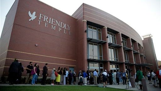 People begin to line up to attend the funeral for Michael Brown Monday in St. Louis. Brown, who is black, was unarmed when he was shot Aug. 9 by Officer Darren Wilson, who is white. A grand jury is considering evidence in the case and a federal investigation is also underway.