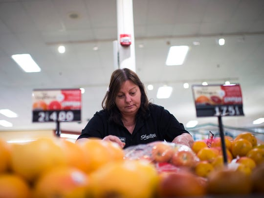 Produce manager Debbie Green culls produce for a food bank Wednesday, May 23, 2018 at ShopRite in Hammonton, N.J.