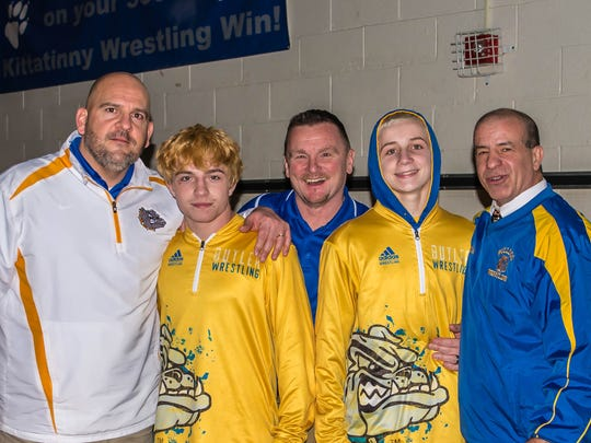 Junior Ben Bariso, second from left and teammate Brandon Wyble, second from right, celebrate with coaches Jason Luciani, (L), Mark Mickens, center, and John Oshea after winning District 2 titles last February.