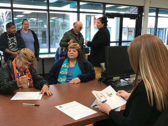 Caleen Sisk, chief and spiritual leader of the Winnemem Wintu Tribe of Shasta County, fills out paperwork Tuesday at the Shasta County Elections Department to run for the California Assembly's 1st District.