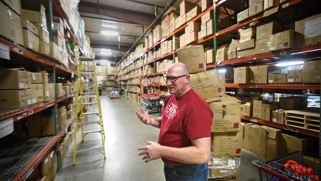 Crafts Direct Manager Scott Schlecht talks Monday, Nov. 21,  about preparations for Black Friday sales. He is shown in the company's warehouse in Waite Park.