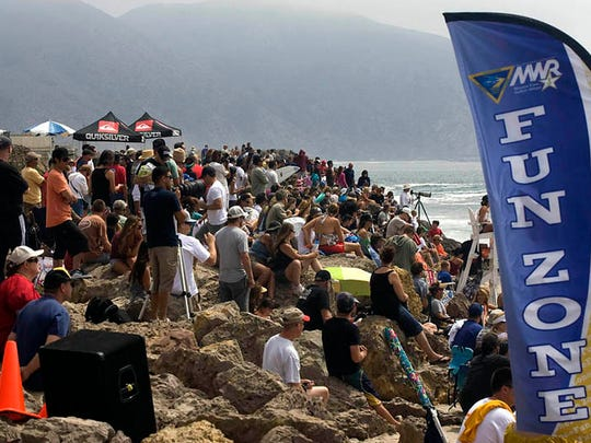 A crowd turns out for one of the annual surf contests