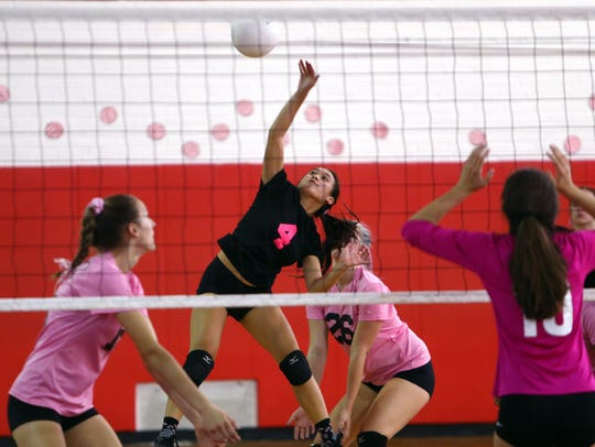 Morris Hills Daisy Nguyen hits vs. Randolph during