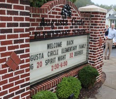 Despite a damp and overcast morning, families were all smiles at Augusta Circle Elementary School in Greenville for the first day of the new school year Aug. 18, 2015.