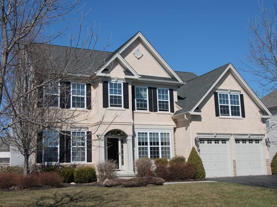 This 13-room home in Clinton Township has a neutral palette, three levels of living and a view of the Spruce Run Recreation Area.
