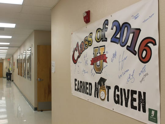 A banner hanging in the hall of Academy Del Sol, APS's