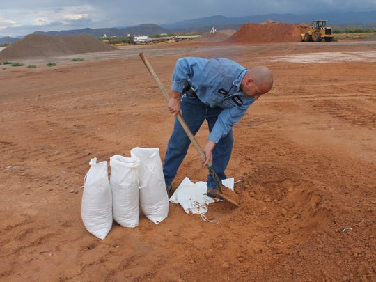 Inventory Specialist for the Otero County Alamogordo Road Shop Patrick Lucero fills up sand bags for residents. The Otero County Road Shop is located at 7085 U.S. Highway 54/70. Residents can pick up sand bags Monday through Thursday from 6:30 a.m. to 5 p.m.