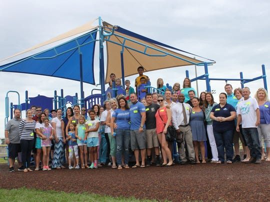 The Clements Family is surrounded by a group of friends,