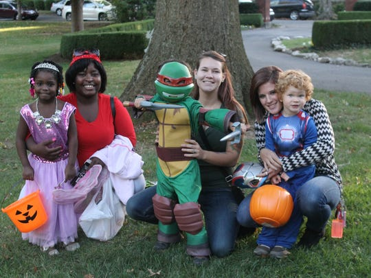 Participants in the Halloween party put on by Dr. and Mrs. Ramsey.