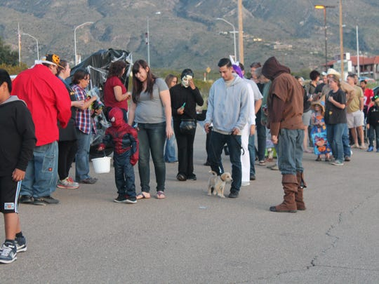 Hundreds of residents lined up in the parking lot of NMSU-A Tays Center for NMSU-A's student organizations' Trunk-or-Treat event Tuesday evening.