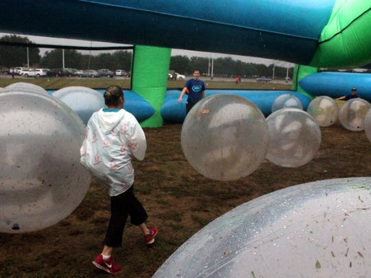 The Insane Inflatable 5K run, a fun, wild, and insane obstacle course shown here at LSUS in Shreveport in 2015 will visit Opelousas in October.