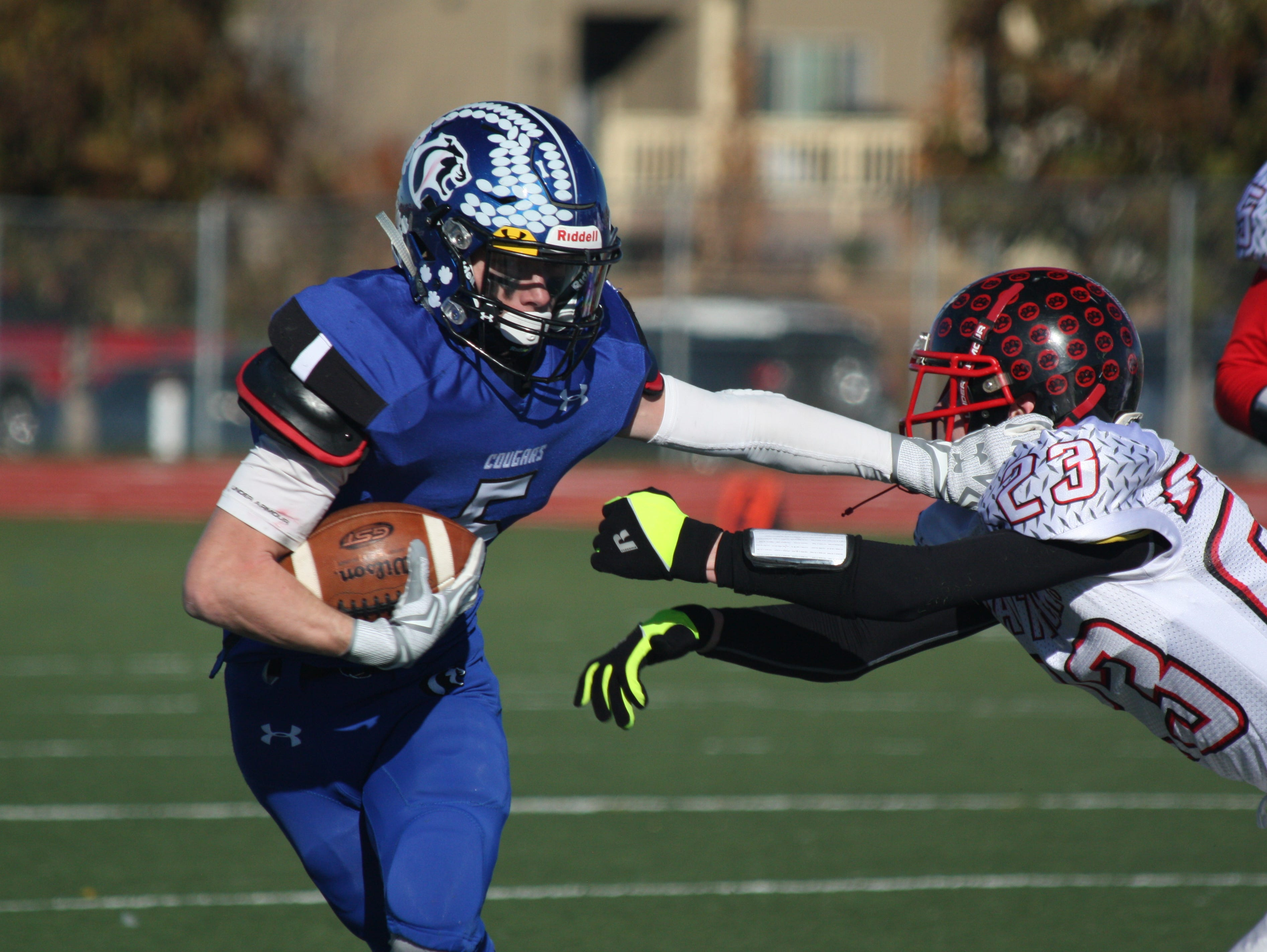 Resurrection Christian's Evan Anderson runs past a Peyton defender during the Cougars' 52-0 first-round playoff win Saturday.