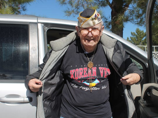 U.S. Navy/Marine Corps veteran and Pearl Harbor survivor Stephen C. DuBois shows off his Korean War veteran t-shirt at Veterans Park in Tularosa after the Veterans Day ceremony.