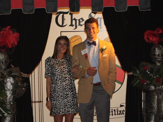 Senior Squire Robert Adams, son of Membership Chairwoman Shawn Adams, and his date Claire Wood are presented during the 2015 Squires Ball.