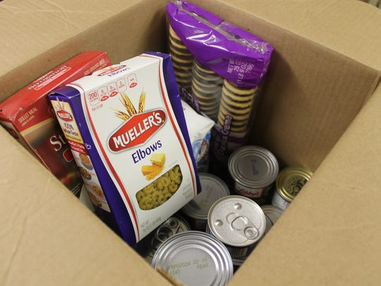 Families who are in need of assistance receive a box of food depending on the size of their family. Most boxes contain pasta, vegetables, fruit, canned meat, tomato sauce, beans, soup and dessert..
